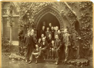 Warden Samuel Barnett with residential volunteers at Toynbee Hall, c. 1903.